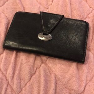 Nine west check holder